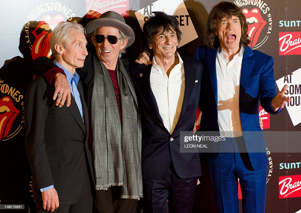 Charlie Watts (L), Keith Richards (2L), Ronnie Wood (2R) and Mick Jagger (R) arrive at Somerset House in central London ahead of a party to celebrate the launch of a book 'Rolling Stones 50' and a photographic exhibition. The Rolling Stones launch a photographic exhibition Thursday marking 50 years since their first gig, as guitarist Keith Richards said the veteran British rock band has been rehearsing again. Mick Jagger, Keith Richards and Brian Jones played the Marquee Club in London on July 12, 1962, the first time they performed under the band name which would change the landscape of pop music forever.