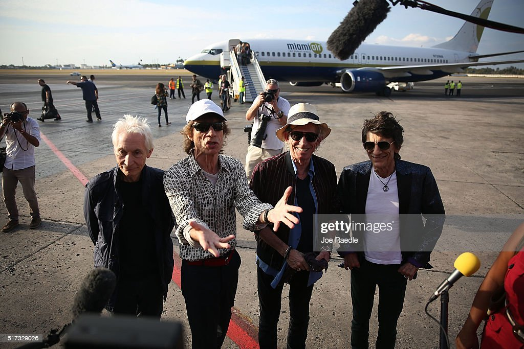 Charlie Watts Mick Jagger Keith Richards and Ronnie Wood of the Rolling Stones talk to media after landing at the Jose Marti International Airport on...