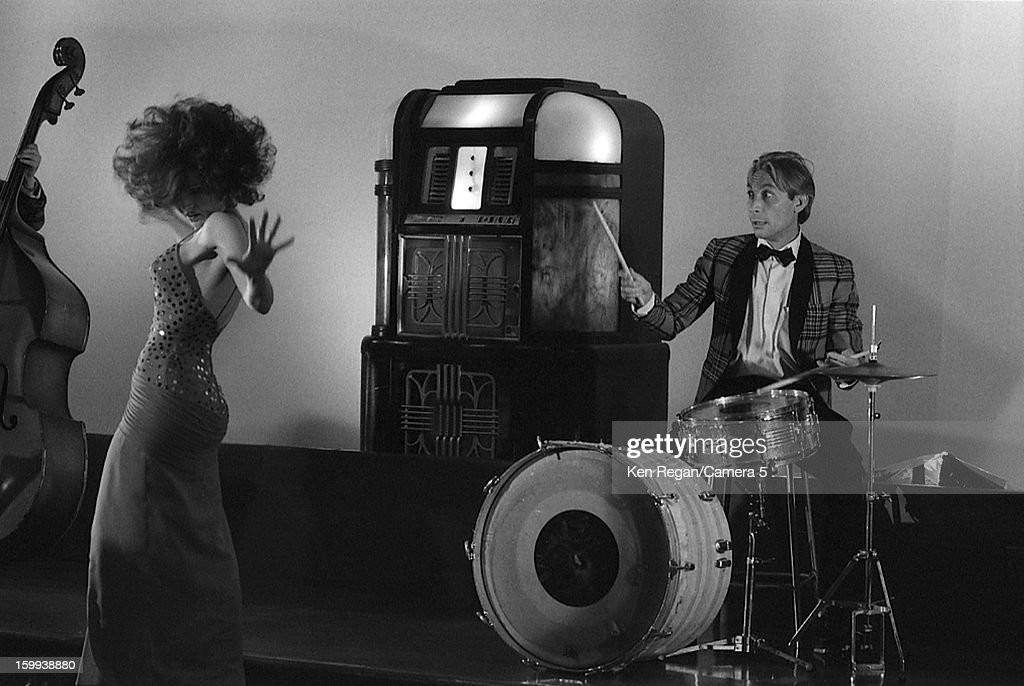 Charlie Watts of The Rolling Stones and actress Anita Morris are photographed on the set of 'She Was Hot' video in January 1984 in New York City.