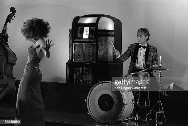 Charlie Watts of The Rolling Stones and actress Anita Morris are photographed on the set of 'She Was Hot' video in January 1984 in New York City...