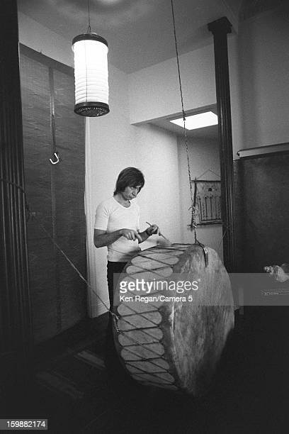 Charlie Watts of the Rolling Stones is photographed playing a large drum at producer Michael Butler's home in 1972 in Los Angeles California CREDIT...