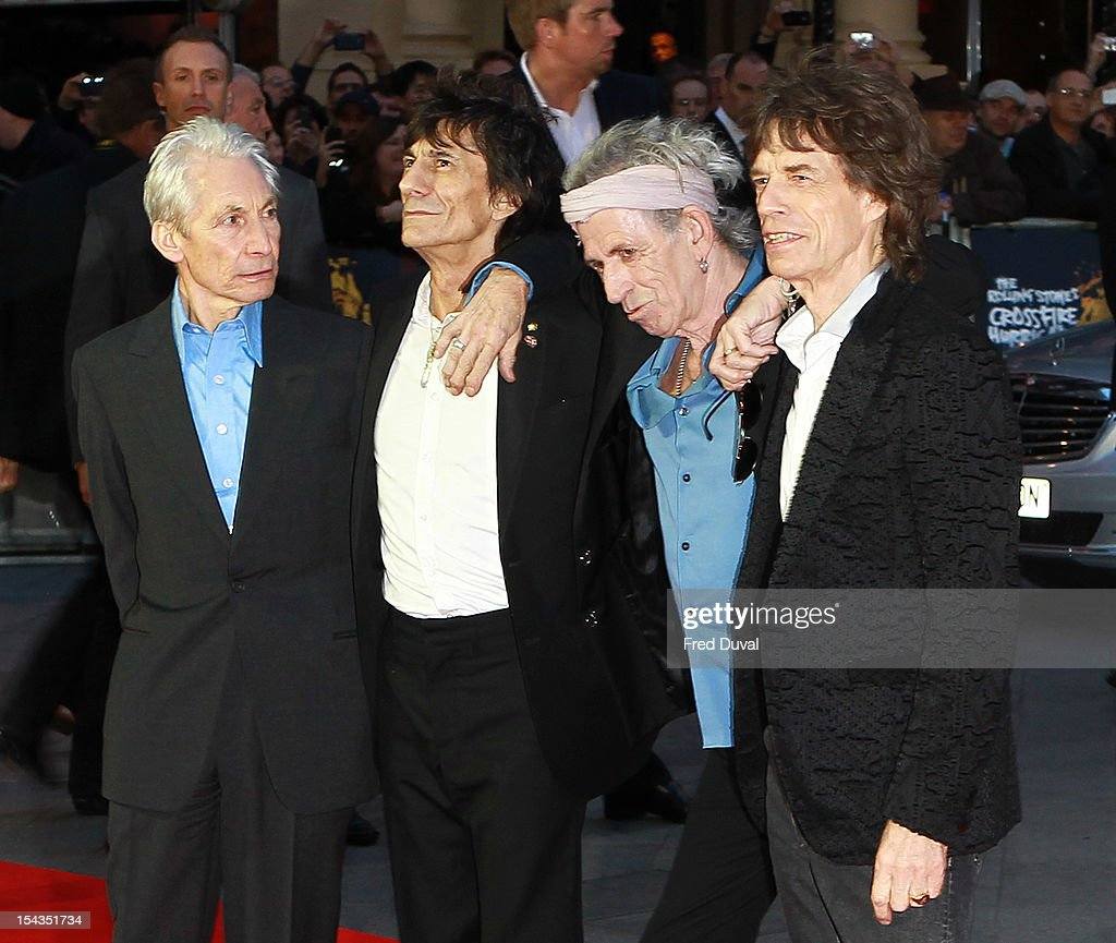 <a gi-track='captionPersonalityLinkClicked' href=/galleries/search?phrase=Charlie+Watts&family=editorial&specificpeople=213325 ng-click='$event.stopPropagation()'>Charlie Watts</a>, Ronnie Wood, <a gi-track='captionPersonalityLinkClicked' href=/galleries/search?phrase=Keith+Richards+-+Musician&family=editorial&specificpeople=202882 ng-click='$event.stopPropagation()'>Keith Richards</a> and <a gi-track='captionPersonalityLinkClicked' href=/galleries/search?phrase=Mick+Jagger&family=editorial&specificpeople=201786 ng-click='$event.stopPropagation()'>Mick Jagger</a> attend the Premiere of 'Crossfire Hurricane' during the 56th BFI London Film Festival at Odeon Leicester Square on October 18, 2012 in London, England.