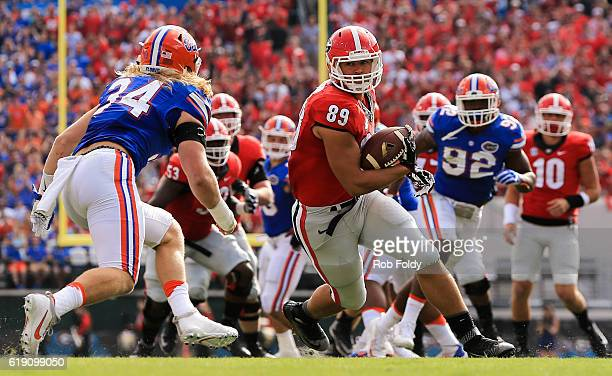 Charlie Werner of the Georgia Bulldogs carries as Alex Anzalone of the Florida Gators defends during the first quarter of the game at EverBank Field...