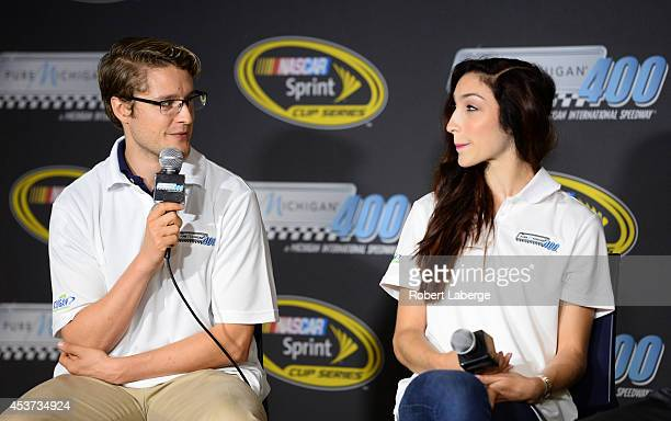 Charlie White and Meryl Davis Olympic ice dancing gold medalists speak to the media prior to the NASCAR Sprint Cup Series Pure Michigan 400 at...
