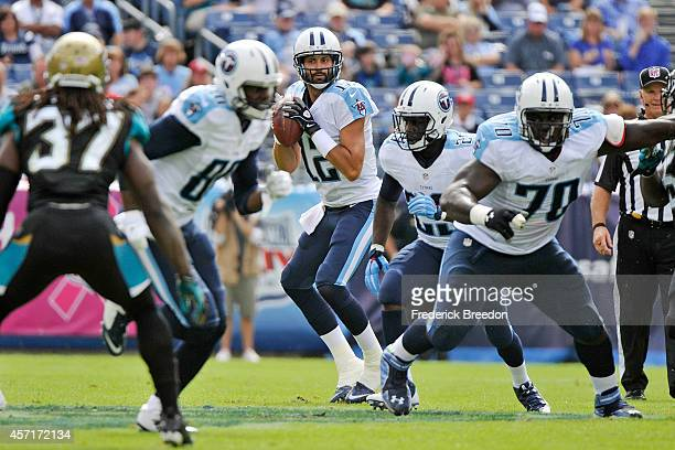 Charlie Whitehurst of the Tennessee Titans drop back to throw a pass behind Chance Warmack during a game against the Jacksonville Jaguars at LP Field...