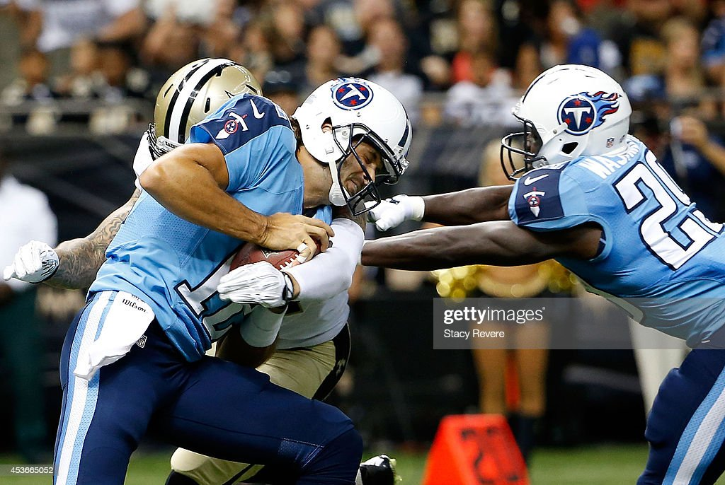 Charlie Whitehurst of the Tennessee Titans tries to run the ball as his teammate Leon Washington blocks during a preseason game against the New...