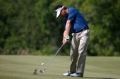 Charlie Wi hits his approach to the 15th green during the first round of the John Deere Classic held at TPC Deere Run on July 10 2014 in Silvis...