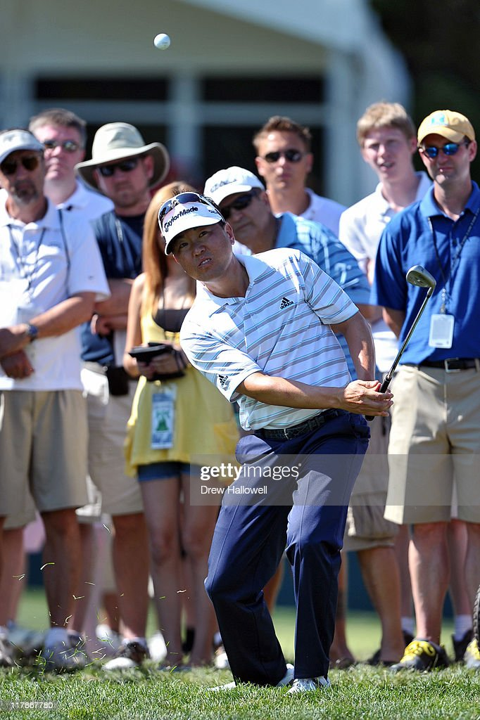 Charlie Wi hits his fourth shot on the ninth hole during the second round of the ATT National at Aronimink Golf Club on June 30 2011 in Newtown...