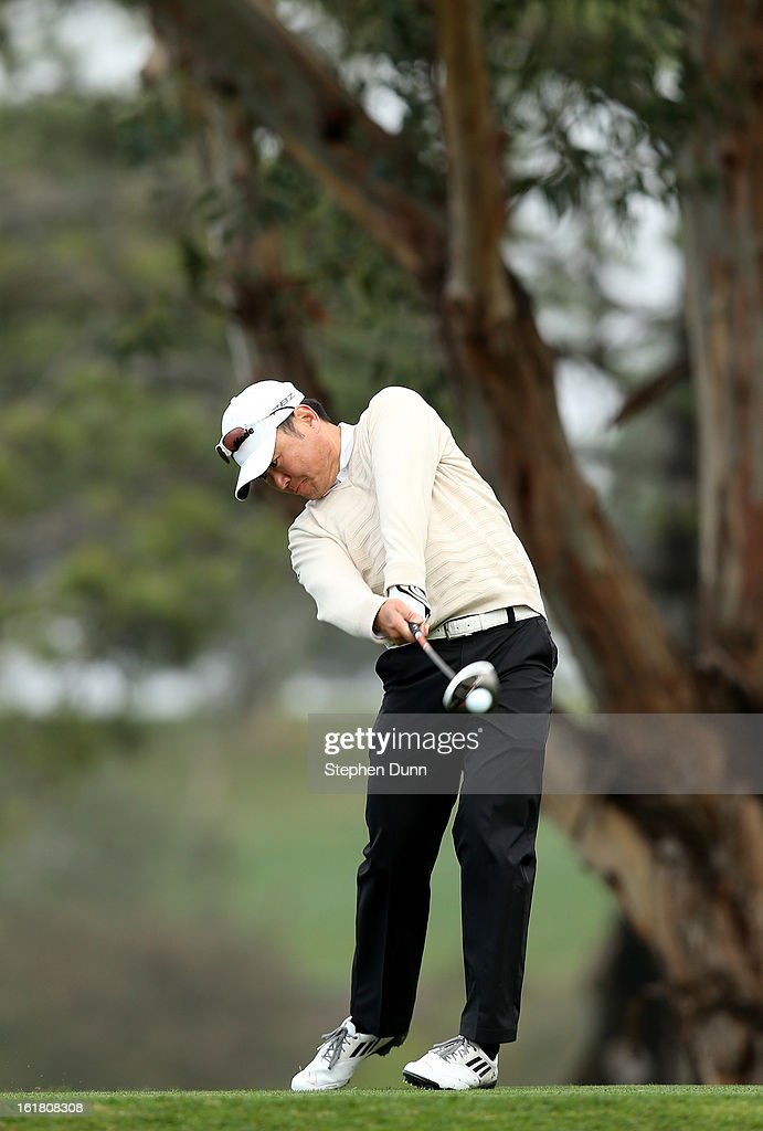 Charlie Wi hits his tee shot on the fifth hole during the third round of the Farmers Insurance Open on the South Course at Torrey Pines Golf Course on January 27, 2013 in La Jolla, California.