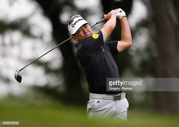 Charlie Wi of Australia watches his tee shot on the 12th hole during the second round of the Webcom Tour Nationwide Children's Hospital Championship...