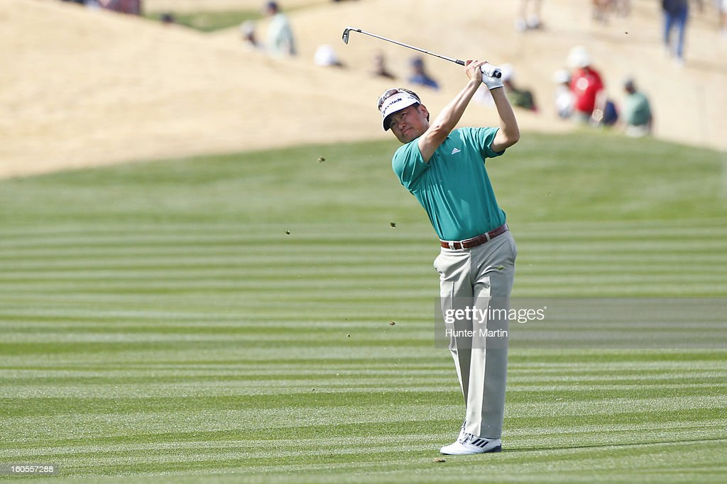 Charlie Wi of Korea hits his second shot on the ninth hole during the third round of the Waste Management Phoenix Open at TPC Scottsdale on February 2, 2013 in Scottsdale, Arizona.