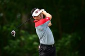 Charlie Wi of Korea plays a shot during round one of the Resorts World Manila Masters at Manila Southwoods Golf and Country Club on November 19 2015...