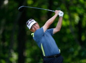 Charlie Wi of Korea watches his tee shot on the 12th hole during the second round of the Travelers Championship golf tournament at the TPC River...
