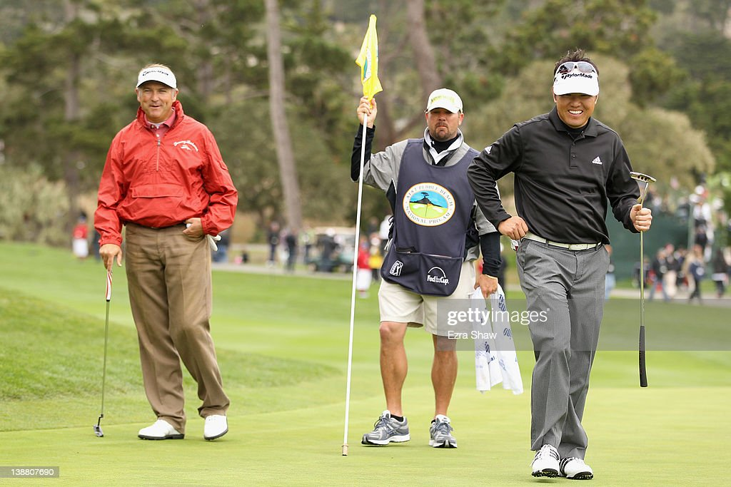 <a gi-track='captionPersonalityLinkClicked' href=/galleries/search?phrase=Charlie+Wi&family=editorial&specificpeople=678470 ng-click='$event.stopPropagation()'>Charlie Wi</a> of South Korea (R) and <a gi-track='captionPersonalityLinkClicked' href=/galleries/search?phrase=Ken+Duke&family=editorial&specificpeople=2551619 ng-click='$event.stopPropagation()'>Ken Duke</a> (L) smiles on the third green during the final round of the AT&T Pebble Beach National Pro-Am at Pebble Beach Golf Links on February 12, 2012 in Pebble Beach, California.