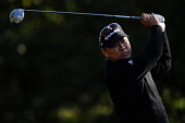 Charlie Wi of South Korea hits a tee shot on the 11th hole during the second round of the Valspar Championship at Innisbrook Resort and Golf Club on...