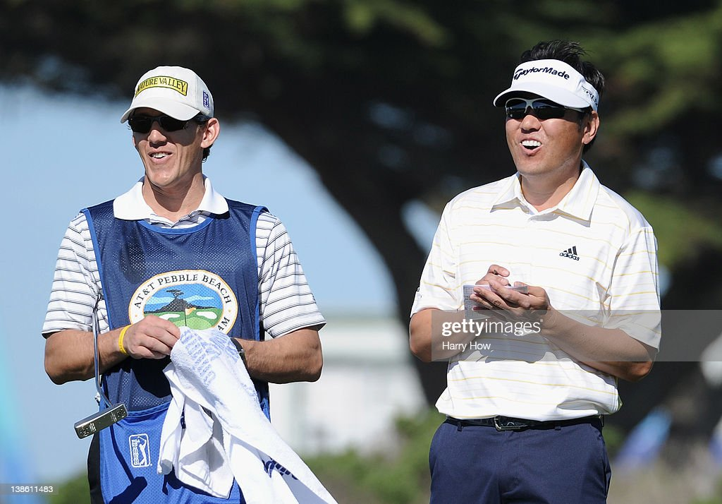 <a gi-track='captionPersonalityLinkClicked' href=/galleries/search?phrase=Charlie+Wi&family=editorial&specificpeople=678470 ng-click='$event.stopPropagation()'>Charlie Wi</a> of South Korea (R) reacts to a putt on the 11th hole alongside his caddie during the first round of the AT&T Pebble Beach National Pro-Am the Monterey Peninsula Country Club (Shore Course) on February 9, 2012 in Pebble Beach, California.