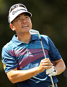 Charlie Wi of South Korea watches his tee shot on the 16th hole during the first round of the Wyndham Championship at Sedgefield Country Club on...