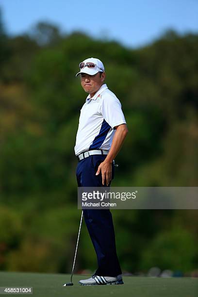 Charlie Wi of the United States misses his birdie putt on the first hole during round one of the Sanderson Farms Championship at The Country Club of...
