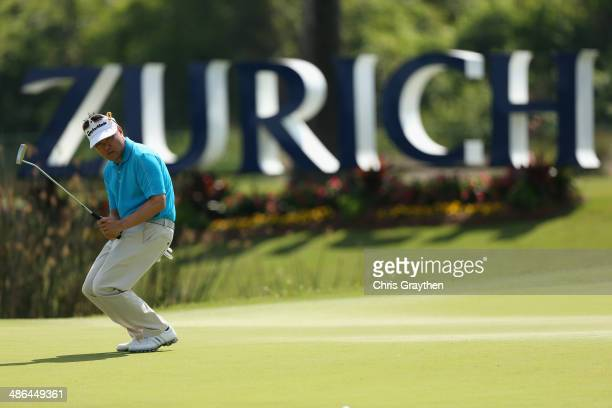 Charlie Wi reacts to a missed birdie putt on the 17th during Round One of the Zurich Classic of New Orleans at TPC Louisiana on April 24 2014 in...