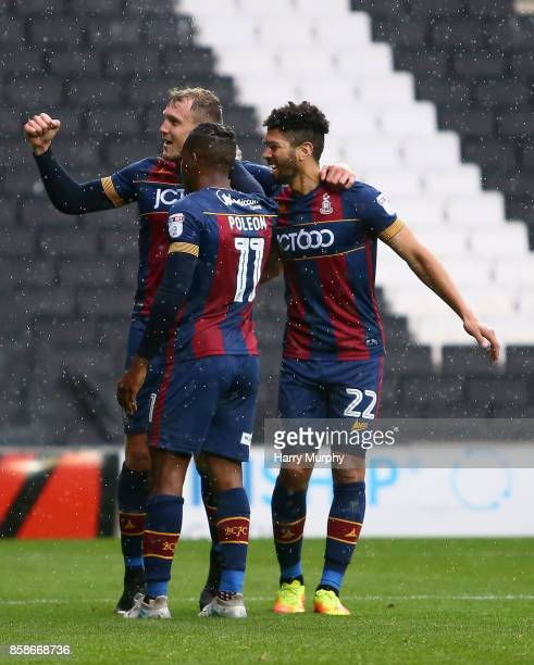 Charlie Wyke of Bradford City celebrates scoring his side's third goal with teammates during the Sky Bet League One match between Milton Keynes Dons...