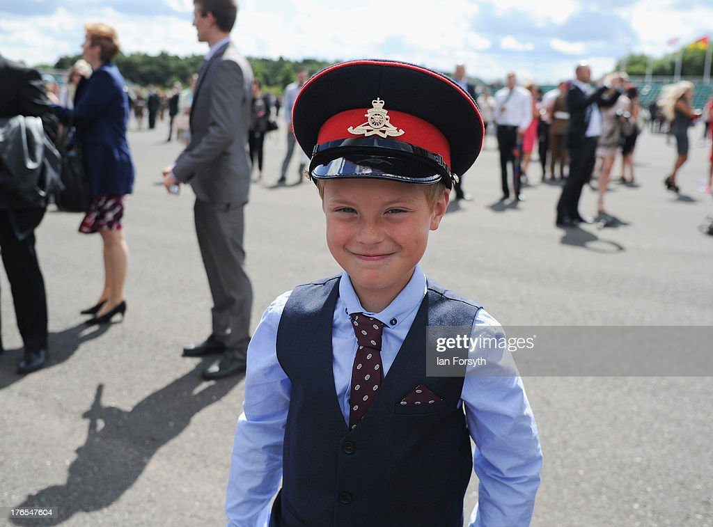 Charlier McKenna, 9, from Chorley wears the cap of his brother Arron Campbell at the end of a graduation parade for Junior Soldiers on August 15, 2013 in Harrogate, England. The Army Foundation College in Harrogate opened in 1998 and provides training for soldiers destined for all the Army's career paths and provides training for 1344 junior soldiers. During their time at the college the students are taught basic military skills and can achieve vocational qualifications, City and Guilds apprenticeships and take part in the Duke of Edinburgh Award Scheme. The graduation parade is the largest in Europe and is only exceeded in size by the Trooping of the Colour in London. Following the parade the students will go on for further specialist training before finally joining their units and moving forward with their military careers.