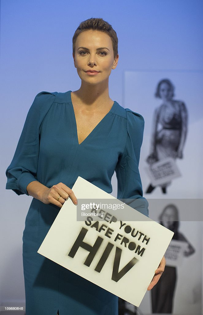 Charlize Theron, a Hollywood actress and celebrity, poses for a photograph during a photocall to promote the Global Fund HIV/Aids campaign during the World Economic Forum (WEF) in Davos, Switzerland, on Tuesday, Jan. 22, 2013. World leaders, Influential executives, bankers and policy makers arrive in the Swiss Alps for the 43rd annual meeting of the World Economic Forum in Davos, the five day event runs from Jan. 23-27. Photographer: Jason Alden/Bloomberg via Getty Images