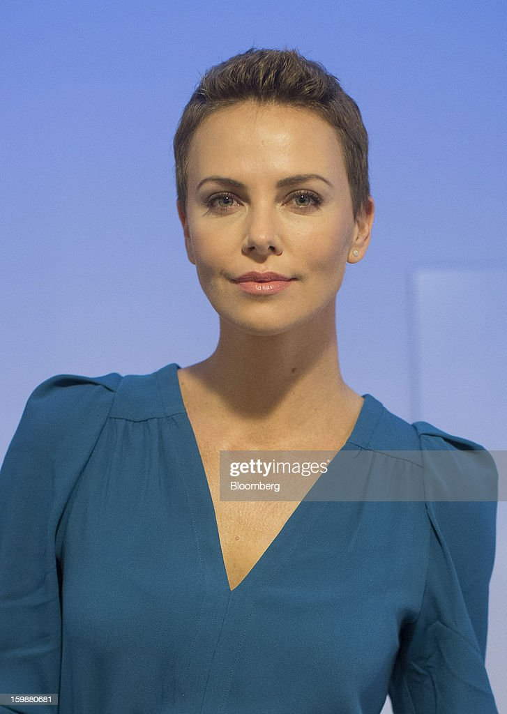 <a gi-track='captionPersonalityLinkClicked' href=/galleries/search?phrase=Charlize+Theron&family=editorial&specificpeople=171250 ng-click='$event.stopPropagation()'>Charlize Theron</a>, a Hollywood actress and celebrity, poses for a photograph during a photocall to promote the Global Fund HIV/Aids campaign during the World Economic Forum (WEF) in Davos, Switzerland, on Tuesday, Jan. 22, 2013. World leaders, Influential executives, bankers and policy makers arrive in the Swiss Alps for the 43rd annual meeting of the World Economic Forum in Davos, the five day event runs from Jan. 23-27. Photographer: Jason Alden/Bloomberg via Getty Images