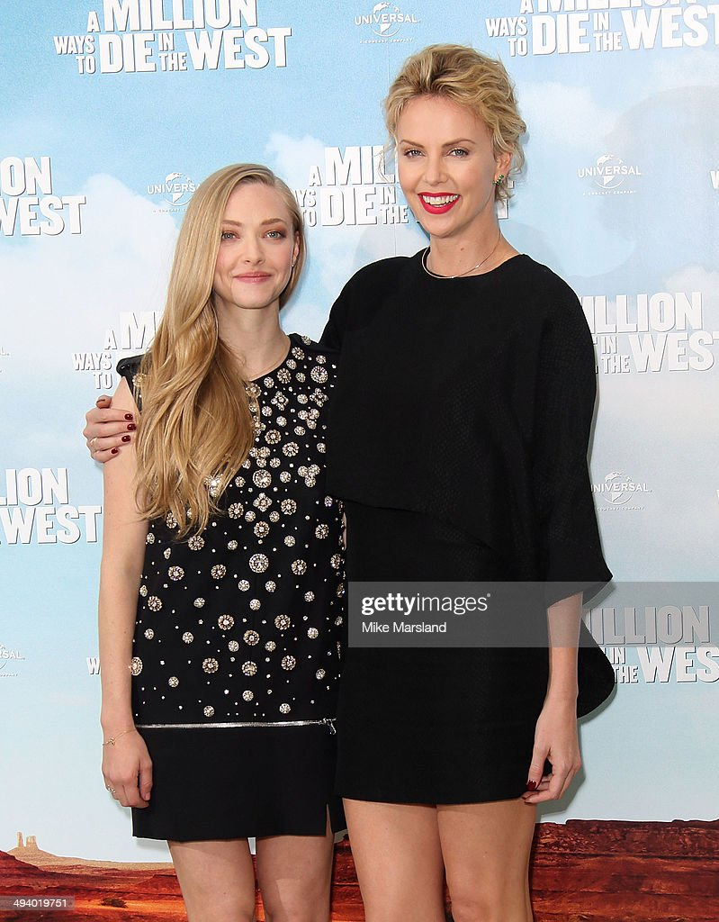<a gi-track='captionPersonalityLinkClicked' href=/galleries/search?phrase=Charlize+Theron&family=editorial&specificpeople=171250 ng-click='$event.stopPropagation()'>Charlize Theron</a> And <a gi-track='captionPersonalityLinkClicked' href=/galleries/search?phrase=Amanda+Seyfried&family=editorial&specificpeople=216619 ng-click='$event.stopPropagation()'>Amanda Seyfried</a> attend photocall to promote 'A Million Ways To Die In The West' on May 27, 2014 in London, England.