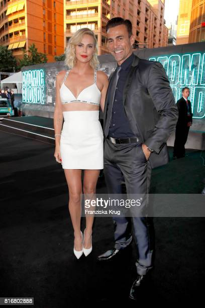 Charlize Theron and Daniel Bernhardt attend the 'Atomic Blonde' world premiere at Stage Theater on July 17 2017 in Berlin Germany