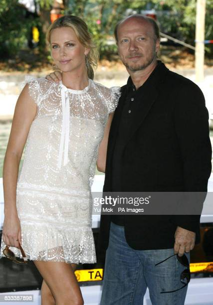 Charlize Theron and director of the film Paul Haggis arriving by boat for 'In the Valley Of Elah' at the Venice Film Festival in Italy