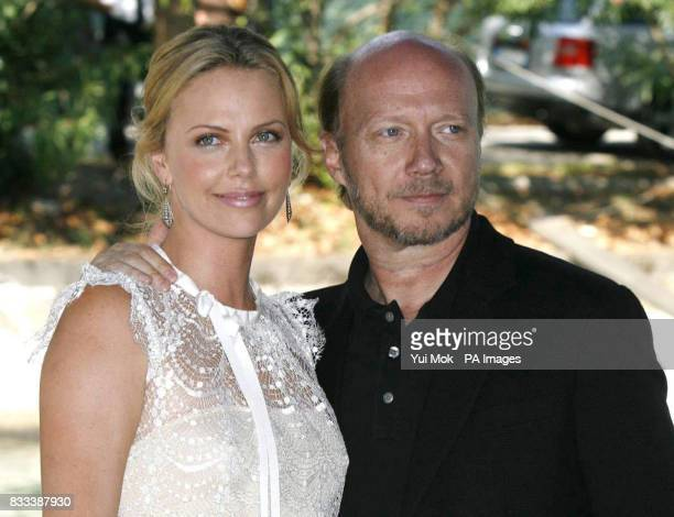 Charlize Theron and director of the film Paul Haggis arriving by boat for 'In the Valley Of Elah' photocall at the Venice Film Festival in Italy