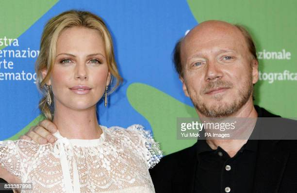 Charlize Theron and director Paul Haggis during a photocall for the film 'In the Valley Of Elah' at the Venice Film Festival in Italy Saturday 1...