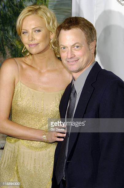 Charlize Theron and Gary Sinise during The 2003 National Board of Review of Motion Pictures Annual Awards Gala at Tavern on The Green in New York...