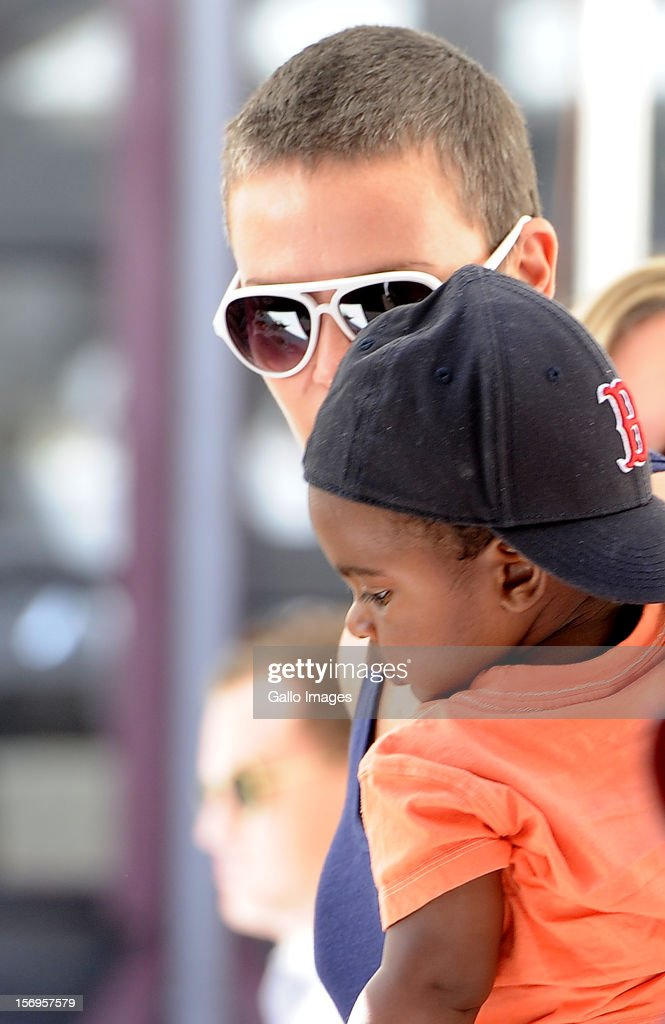 <a gi-track='captionPersonalityLinkClicked' href=/galleries/search?phrase=Charlize+Theron&family=editorial&specificpeople=171250 ng-click='$event.stopPropagation()'>Charlize Theron</a> and her adopted son, Jackson, in Green Point on November 23, 2012 in Cape Town, South Africa. The actress is in Cape Town to shoot the final scenes for the Australian blockbuster 'Mad Max 4: Fury Road'.