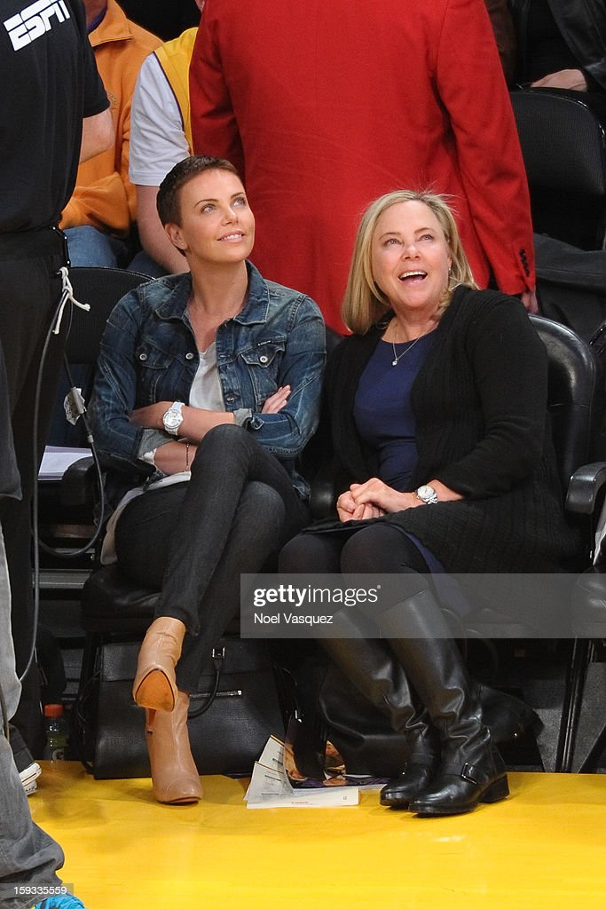 <a gi-track='captionPersonalityLinkClicked' href=/galleries/search?phrase=Charlize+Theron&family=editorial&specificpeople=171250 ng-click='$event.stopPropagation()'>Charlize Theron</a> and her mother Gerda a basketball game between the Oklahoma City Thunder and the Los Angeles Lakers at Staples Center on January 11, 2013 in Los Angeles, California.