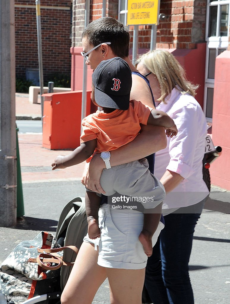 <a gi-track='captionPersonalityLinkClicked' href=/galleries/search?phrase=Charlize+Theron&family=editorial&specificpeople=171250 ng-click='$event.stopPropagation()'>Charlize Theron</a> and her mother Gerda and her adopted son, Jackson, in Green Point on November 23, 2012 in Cape Town, South Africa. The actress is in Cape Town to shoot the final scenes for the Australian blockbuster 'Mad Max 4: Fury Road'.