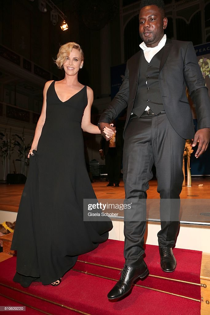 Charlize Theron and Kweku Mandela, grandson of Nelson Mandela during the Cinema For Peace Gala 2016 during the 66th Berlinale International Film Festival on February 15, 2016 in Berlin, Germany.