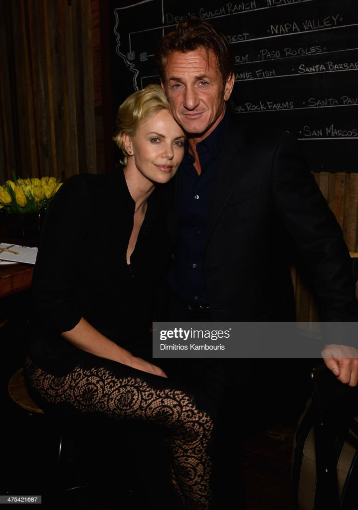 <a gi-track='captionPersonalityLinkClicked' href=/galleries/search?phrase=Charlize+Theron&family=editorial&specificpeople=171250 ng-click='$event.stopPropagation()'>Charlize Theron</a> and <a gi-track='captionPersonalityLinkClicked' href=/galleries/search?phrase=Sean+Penn&family=editorial&specificpeople=202979 ng-click='$event.stopPropagation()'>Sean Penn</a> attend Bionic Yarn, G-Star and Hennessy Privilege Celebrate Pharrell Williams and his Oscar nominated single, 'Happy' on February 27, 2014 in Los Angeles, California.