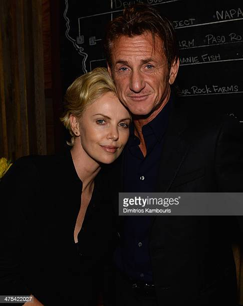 Charlize Theron and Sean Penn attend Bionic Yarn GStar and Hennessy Privilege Celebrate Pharrell Williams and his Oscar nominated single 'Happy' on...