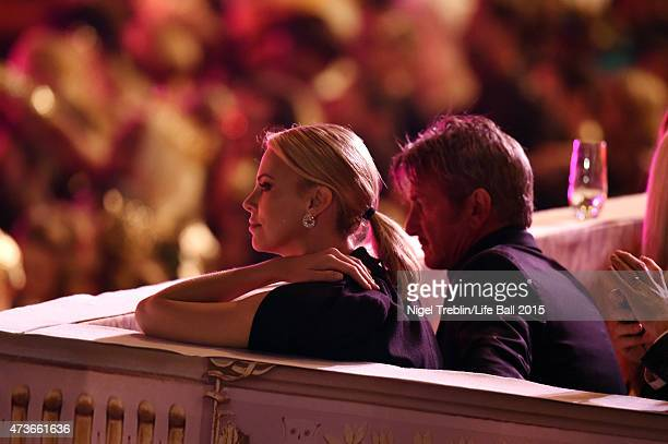 Charlize Theron and Sean Penn watch the Life Ball 2015 show at City Hall on May 16 2015 in Vienna Austria