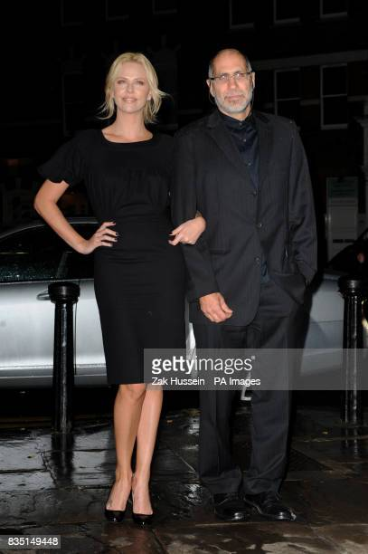 Charlize Theron and writer Guillermo Arriaga arrive for a QA screening of her new film The Burning Plain at the Everyman Cinema in Hampstead north...