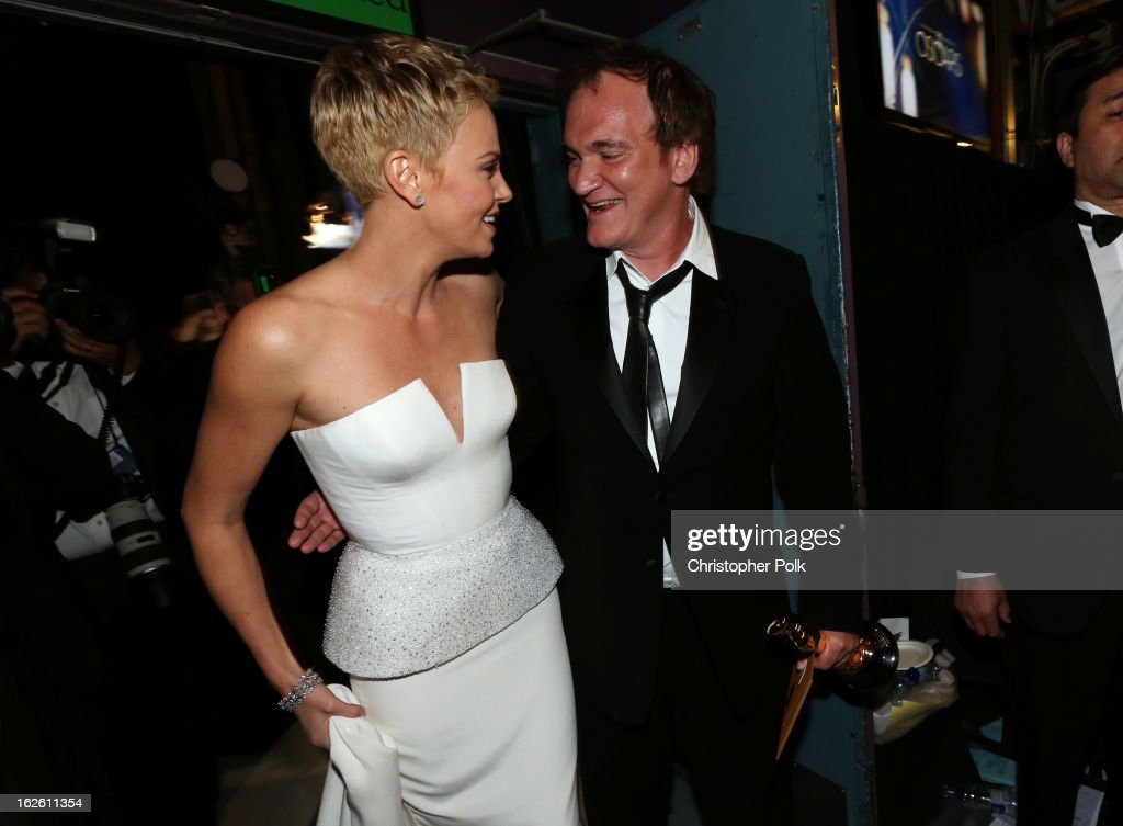 <a gi-track='captionPersonalityLinkClicked' href=/galleries/search?phrase=Charlize+Theron&family=editorial&specificpeople=171250 ng-click='$event.stopPropagation()'>Charlize Theron</a> and Writer/director <a gi-track='captionPersonalityLinkClicked' href=/galleries/search?phrase=Quentin+Tarantino&family=editorial&specificpeople=171796 ng-click='$event.stopPropagation()'>Quentin Tarantino</a> winner of the Best Writing - Original Screenplay Backstage during the Oscars held at the Dolby Theatre on February 24, 2013 in Hollywood, California.