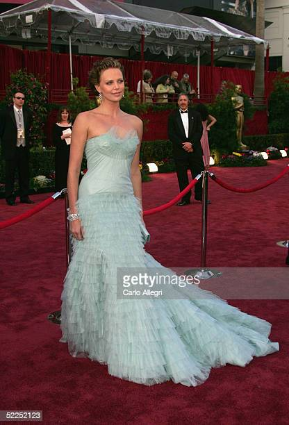 Charlize Theron arrives at the 77th Annual Academy Awards at the Kodak Theater on February 27 2005 in Hollywood California