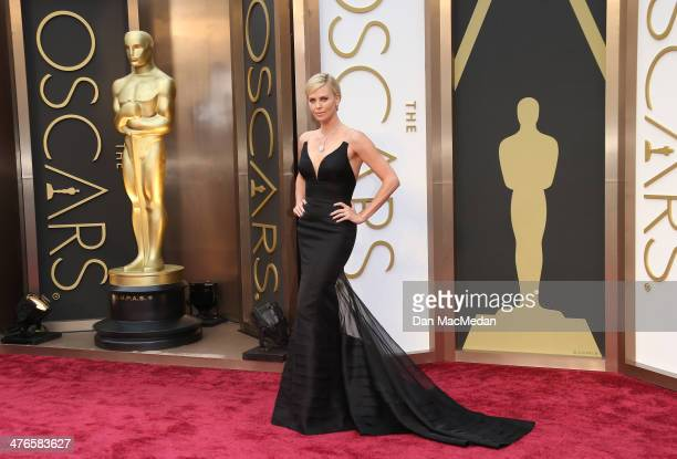 Charlize Theron arrives at the 86th Annual Academy Awards at Hollywood Highland Center on March 2 2014 in Los Angeles California