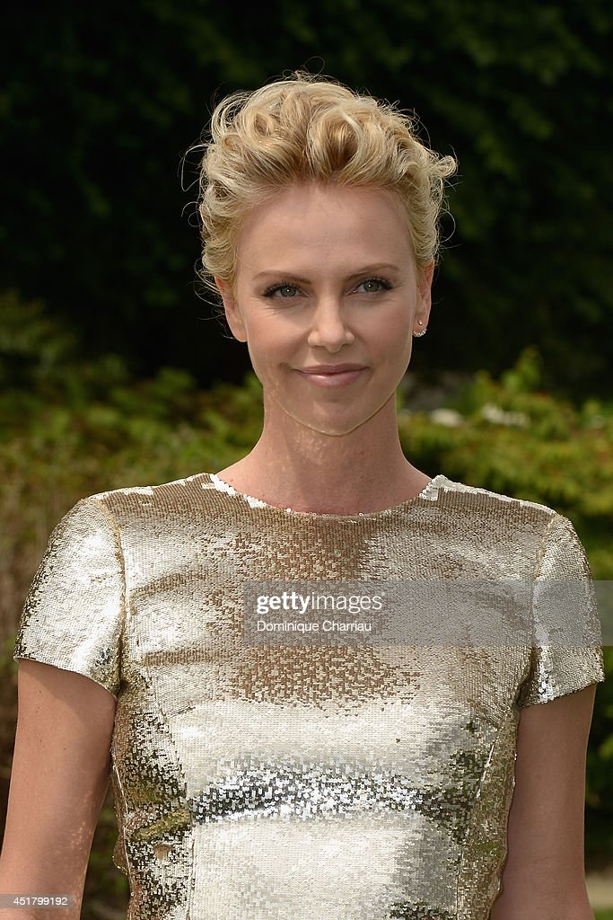 <a gi-track='captionPersonalityLinkClicked' href=/galleries/search?phrase=Charlize+Theron&family=editorial&specificpeople=171250 ng-click='$event.stopPropagation()'>Charlize Theron</a> attends at the Christian Dior show as part of Paris Fashion Week - Haute Couture Fall/Winter 2014-2015 at on July 7, 2014 in Paris, France.