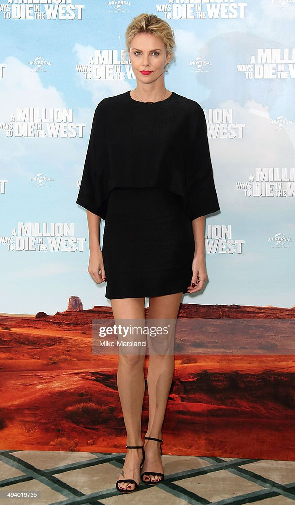 <a gi-track='captionPersonalityLinkClicked' href=/galleries/search?phrase=Charlize+Theron&family=editorial&specificpeople=171250 ng-click='$event.stopPropagation()'>Charlize Theron</a> attends photocall to promote 'A Million Ways To Die In The West' on May 27, 2014 in London, England.