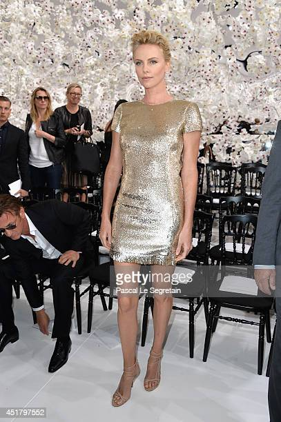 Charlize Theron attends the Christian Dior show as part of Paris Fashion Week Haute Couture Fall/Winter 20142015 on July 7 2014 in Paris France