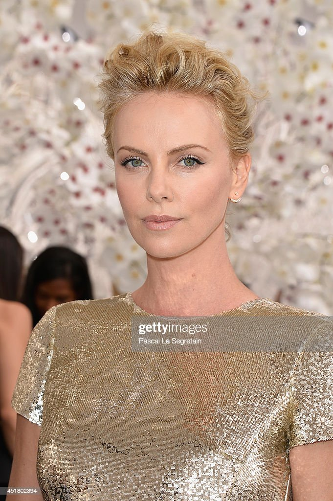 <a gi-track='captionPersonalityLinkClicked' href=/galleries/search?phrase=Charlize+Theron&family=editorial&specificpeople=171250 ng-click='$event.stopPropagation()'>Charlize Theron</a> attends the Christian Dior show as part of Paris Fashion Week - Haute Couture Fall/Winter 2014-2015 on July 7, 2014 in Paris, France.