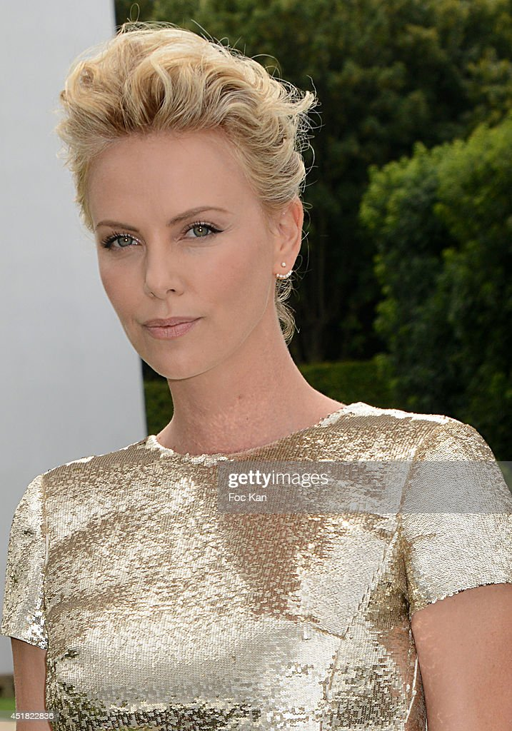 <a gi-track='captionPersonalityLinkClicked' href=/galleries/search?phrase=Charlize+Theron&family=editorial&specificpeople=171250 ng-click='$event.stopPropagation()'>Charlize Theron</a> attends the Christian Dior Show as part of Paris Fashion Week - Haute Couture Fall/Winter 2014-2015 at Musee Rodin on July 7, 2014 in Paris, France.
