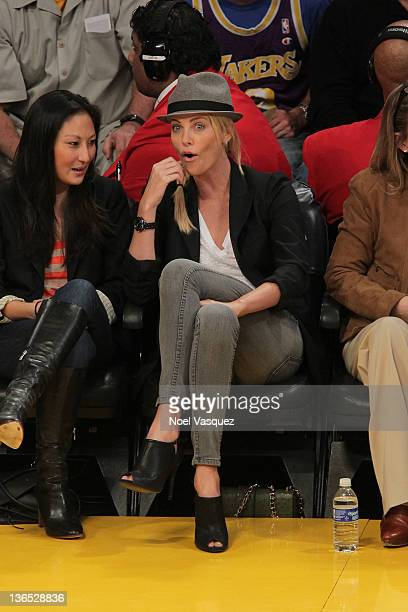 Charlize Theron attends the Los Angeles Lakers vs Golden State Warriors game at Staples Center on January 6 2012 in Los Angeles California